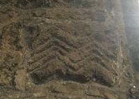 Norman Chevron tile on North wall of church