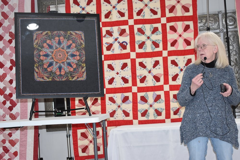 - Gloria Reeves shows a Alzheimer's Quilt she had framed.