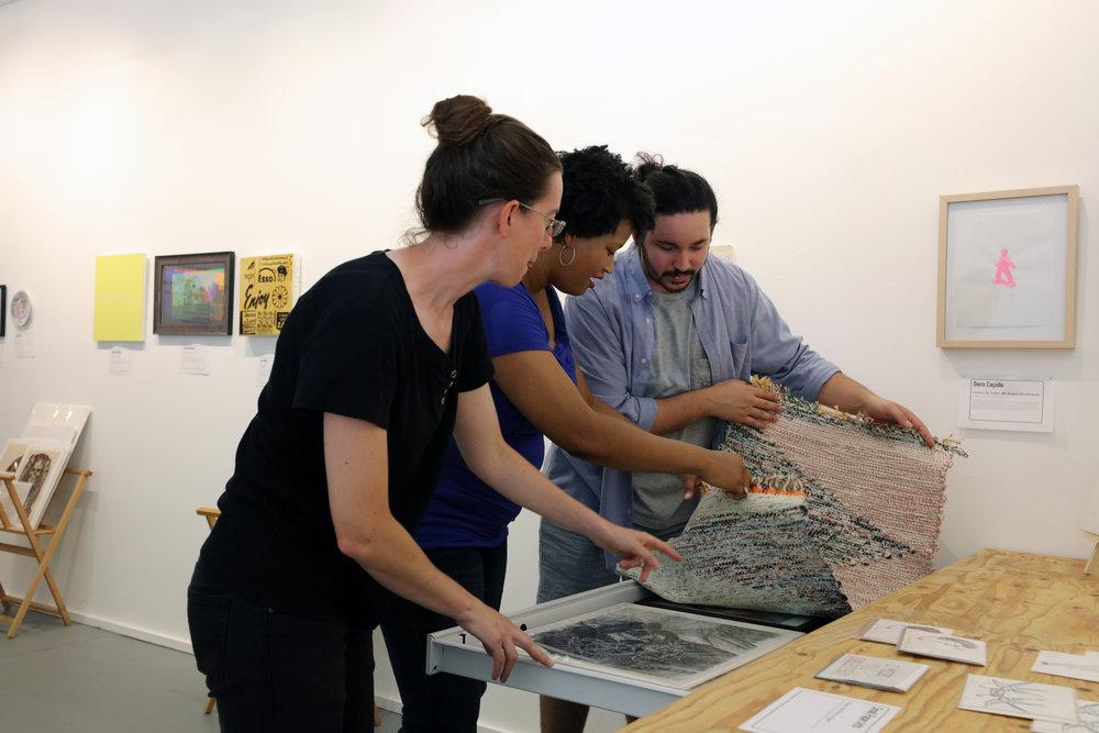 Co-Director Emma Wilcox, Gallery Manager Candace Nicholson, and Registrar Juno Zago  | Photo Credit: Anthony Alvarez