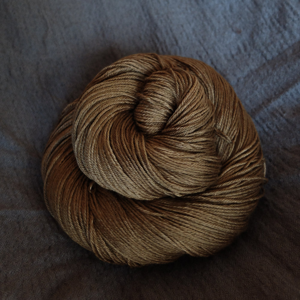Dragon Gold shown on Fingering - Merino/Silk