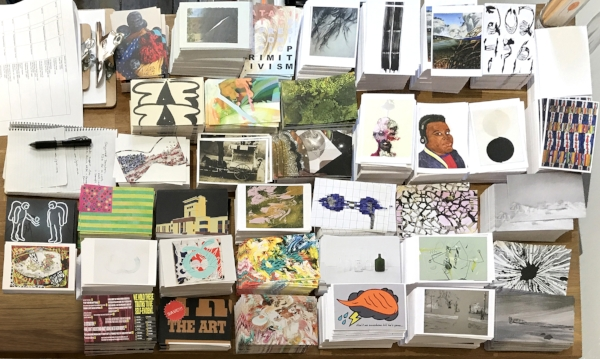 Give-Voice-Postcards-on-table.jpg