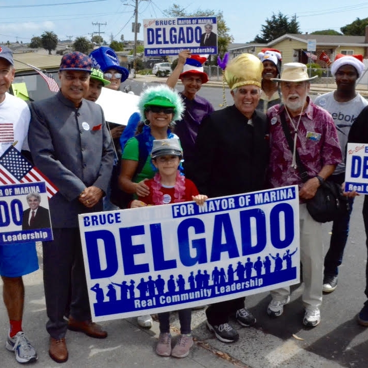 Delgado with Supporters Holding Signs.jpg