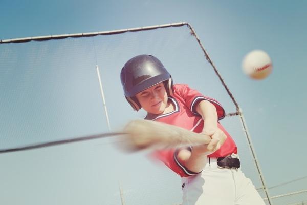 young_baseball_player_hitting_ball.jpg