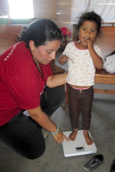 Weighing_a_child_in_Honduras.jpg
