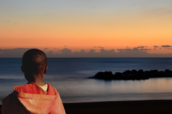 African_boy_looks_across_ocean.jpg