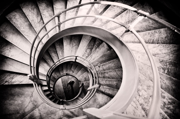 woman_at_center_of_spiral_staircase.jpg
