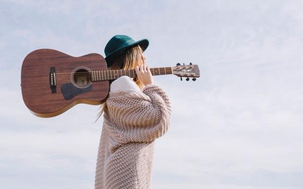 woman_guitar_outside.jpg