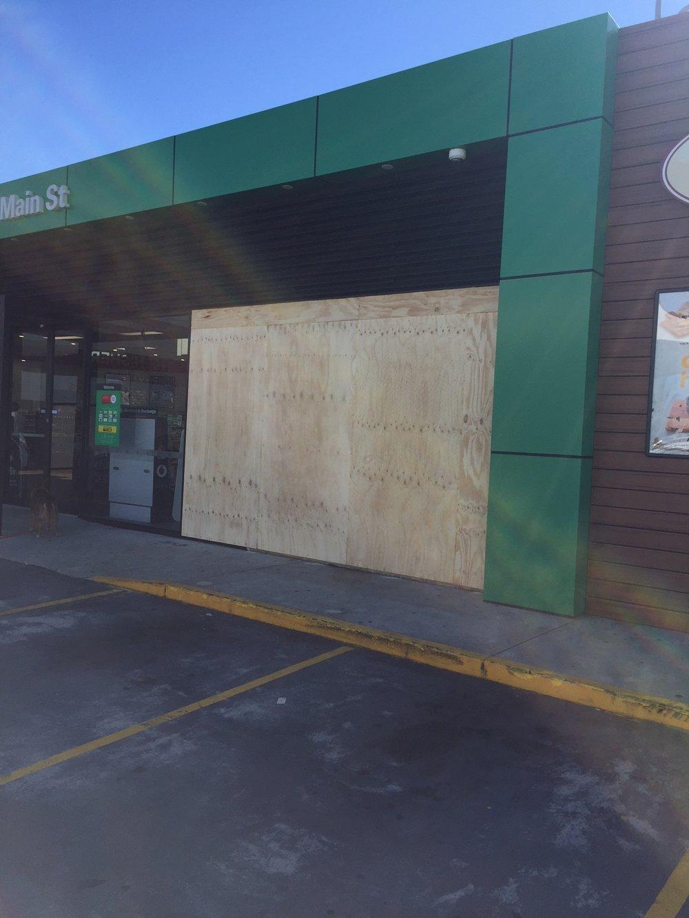 BP Connect Main St - Car through shop front.JPG