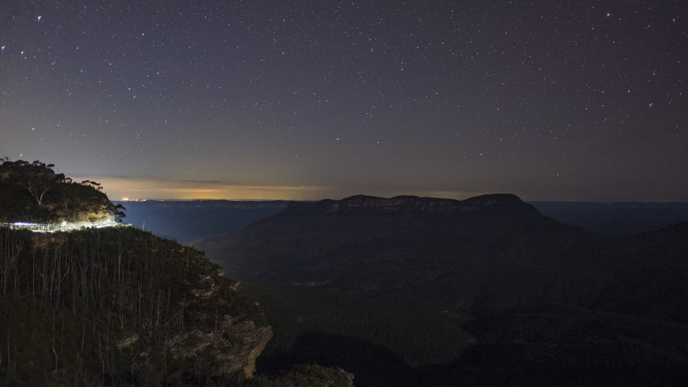 Jamison Valley, Katoomba, Blue Mountains at night with views of the Sydney skyline in the background Image credit: Hamish Weir,  Unsplash