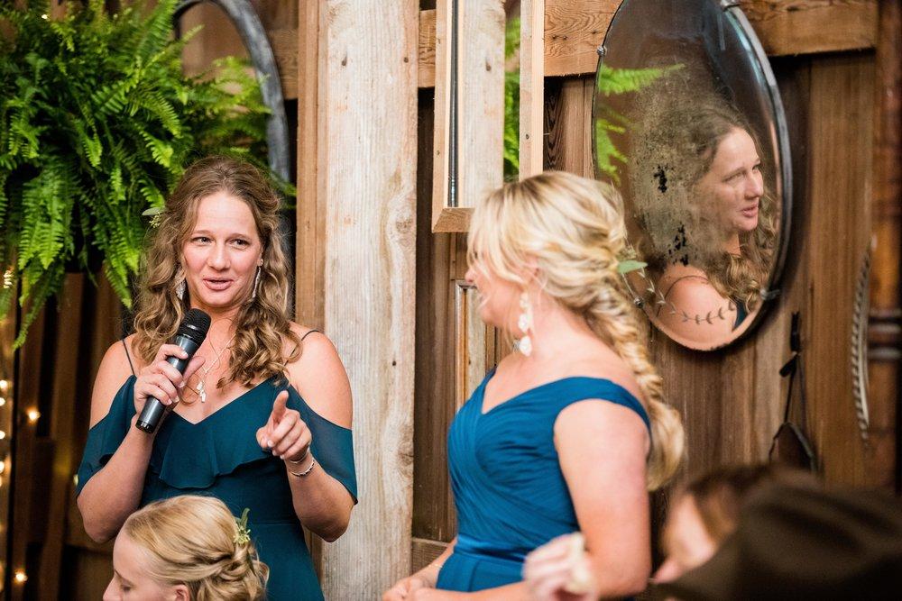Toasts at Reception in Barn Wedding Venue