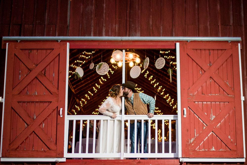 Bride and Groom in Barn Window