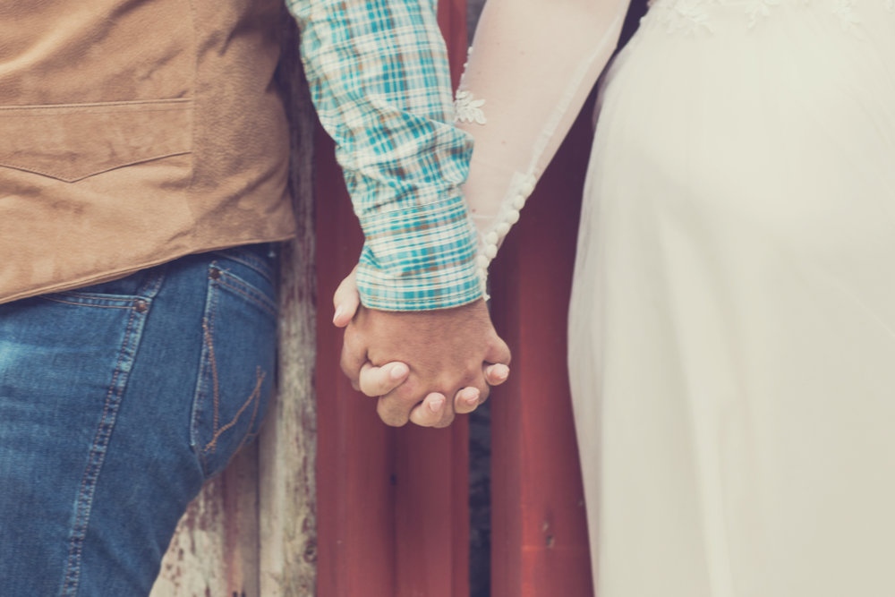 Couple Holds Hands during First Look