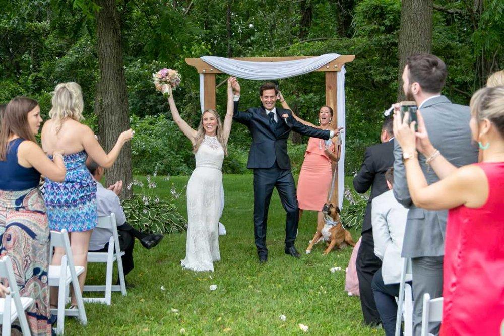 Outdoor ceremony - couple celebrates after saying I Do