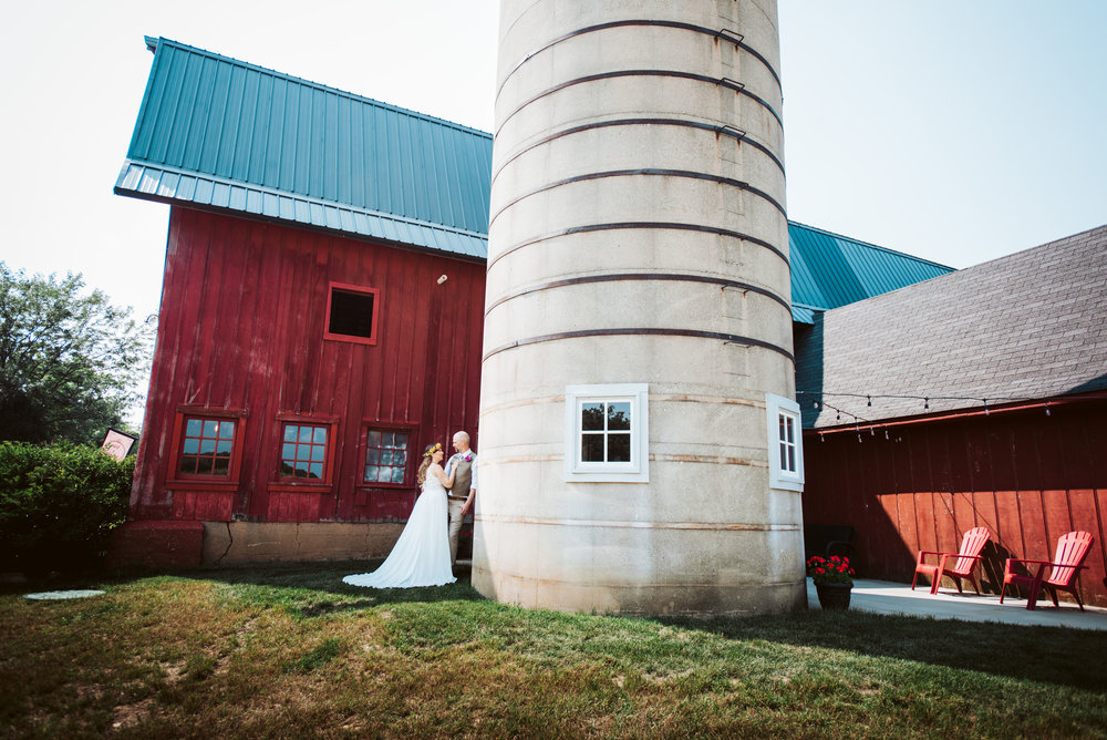 Bride and Groom Pose for Romantic Photo by Silo