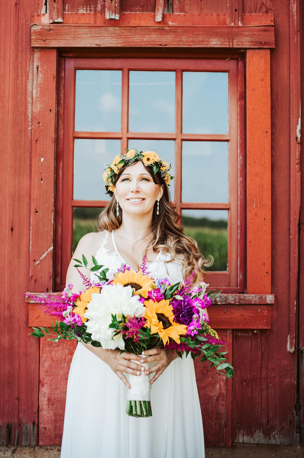 Beautiful Bride in front of Barn Wedding Venue