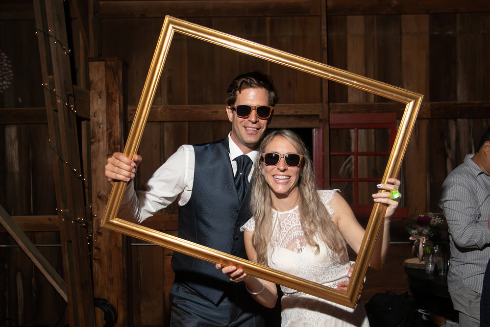 Bride and Groom Pose with Props