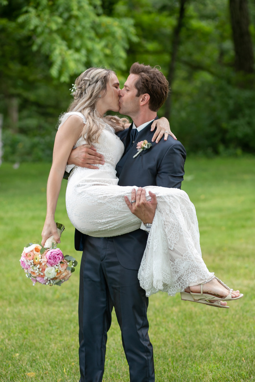 Groom Carries New Bride