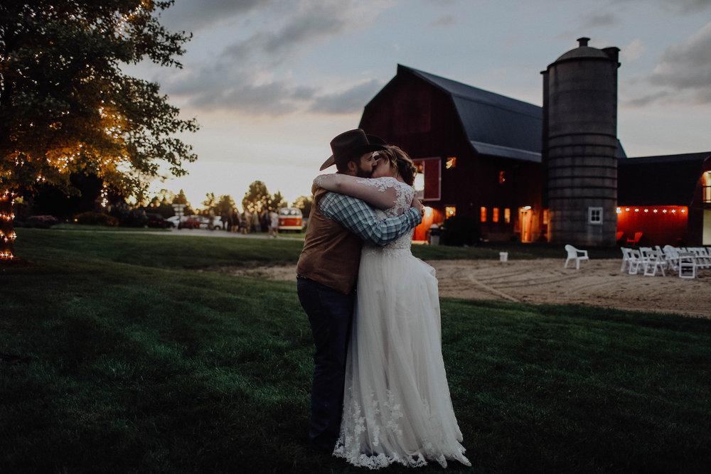 bride-groom-kiss-at-dusk-at-barn-wedding-venue.jpeg