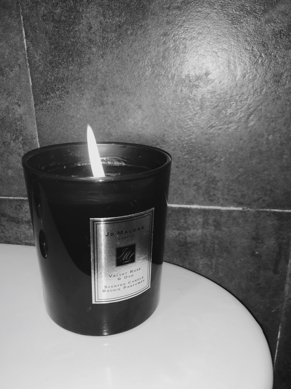 """Darkest Damask rose. Rich and textural, wrapped with smoky oud wood. Spiked with clove, decadent with praline."" - — Jo Malone London (www.jomalone.com)"