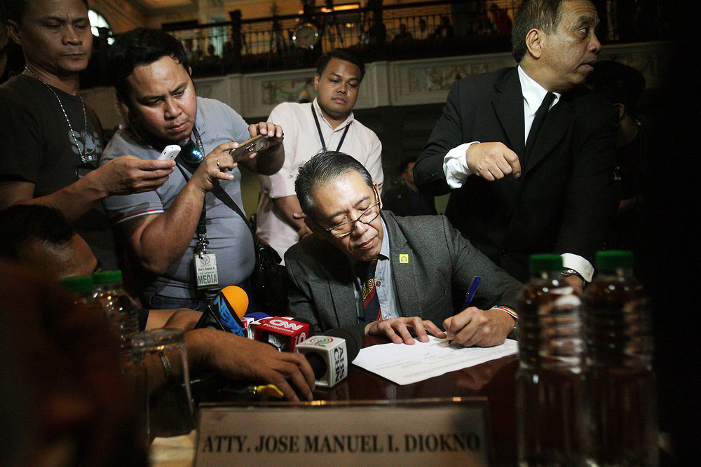 "Atty. Chel at the Supreme Court , before the start of the oral argument on the legality of the Philippine government's ""War on Drugs. Photo by Miguel de Guzman of The Philippine STAR."