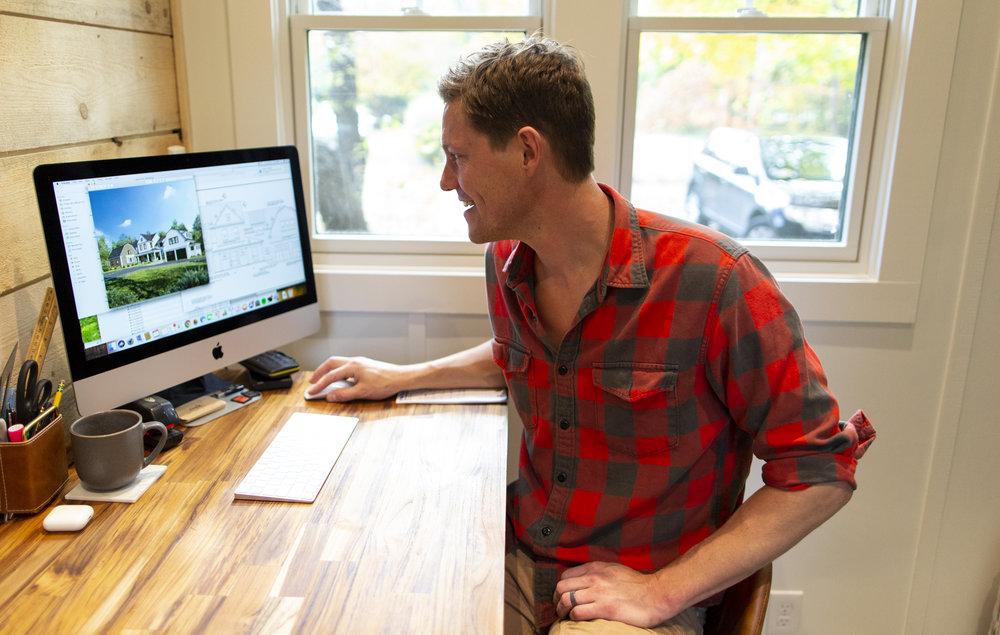 PJ reviews the final project plans.