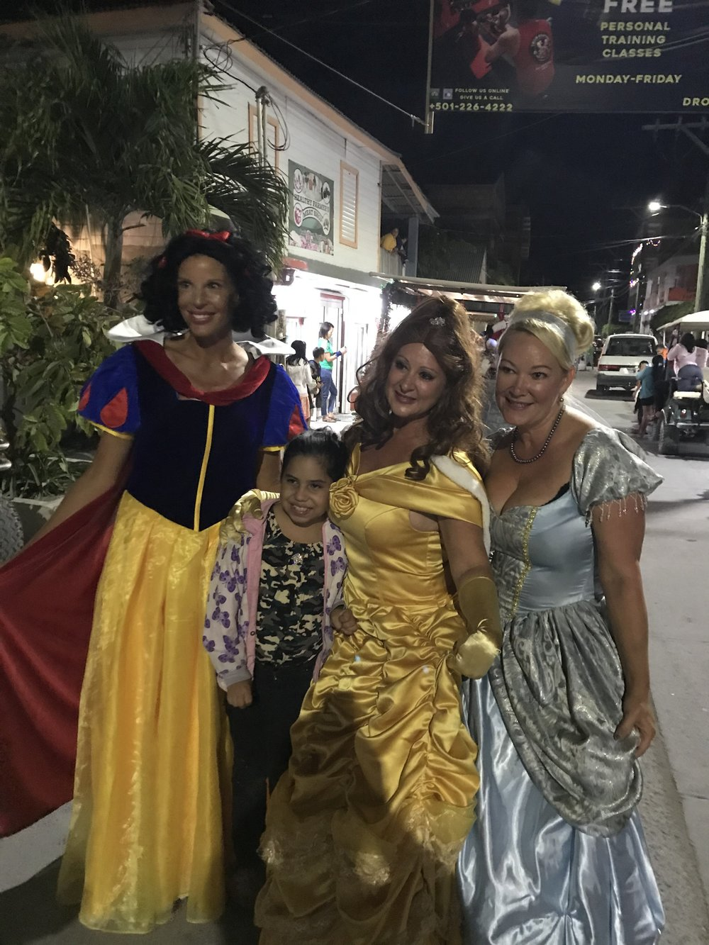The three Disney Princesses and one of the many kids who rushed them!