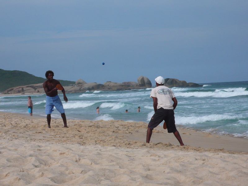 Guys playing paddle ball in Florianopolis.