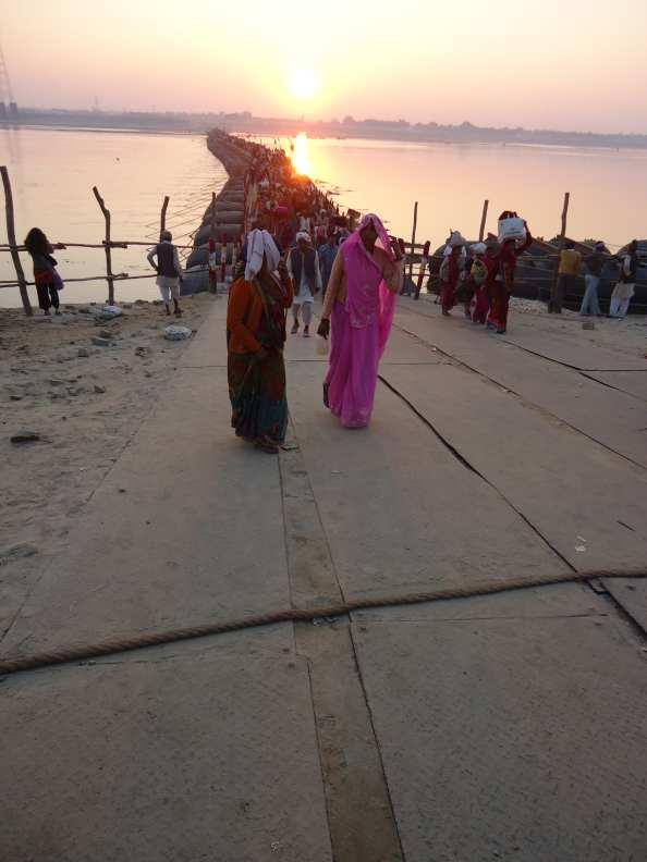 Setting sun illuminates pilgrims