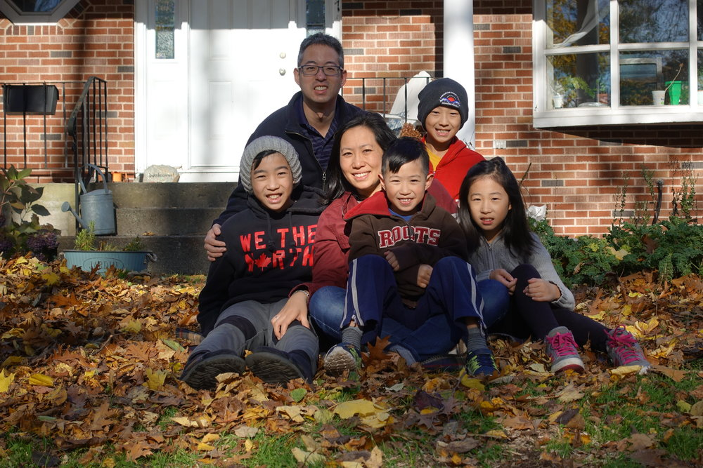 The Chung family offer a smile in the fall leaves!