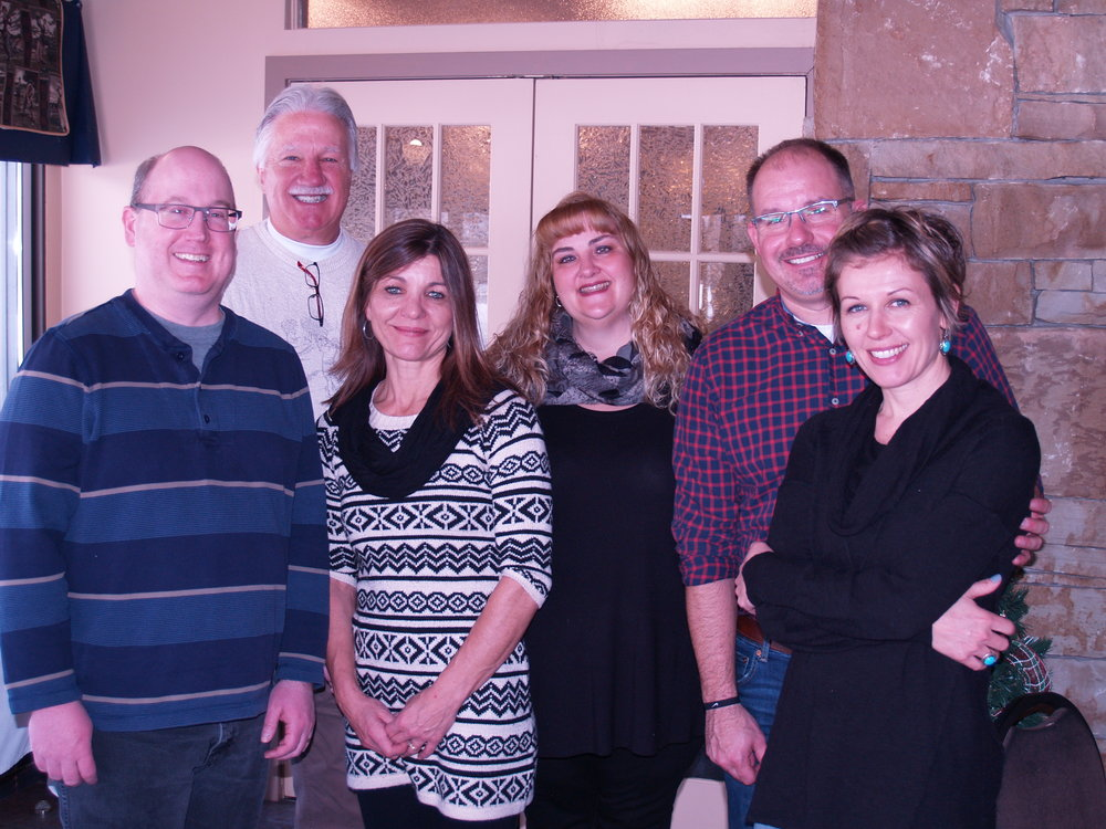 Todd is pictured with his wife Julie on the far right, along with their leadership team.