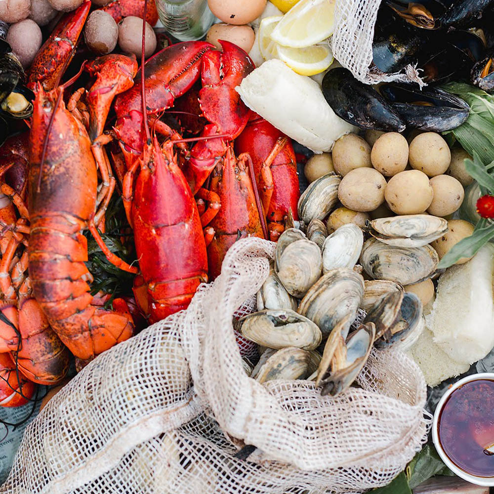 Show your guests a classic Maine experience with our Maine-style lobster bake. Whether we're on the beach, in the backyard of an airbnb, or outside your wedding barn venue, this relaxed taste of vacationland is always a fan favorite.