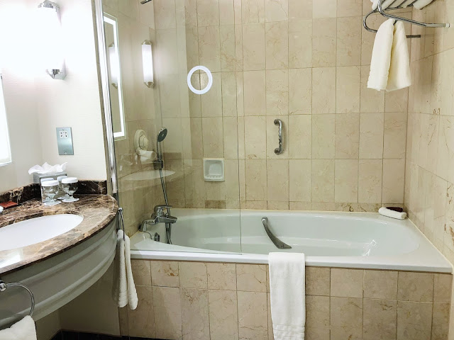 Conrad Dublin hotel review: King Premier Room bathroom with tub and shower