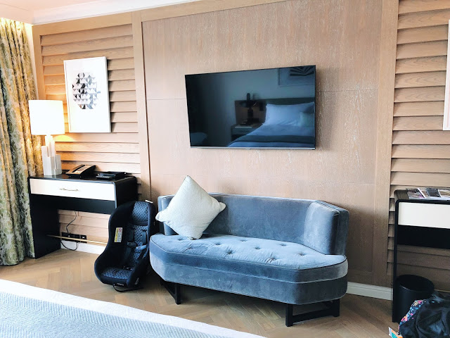 Conrad Dublin hotel review: King Premier Room television, desk area, and chaise
