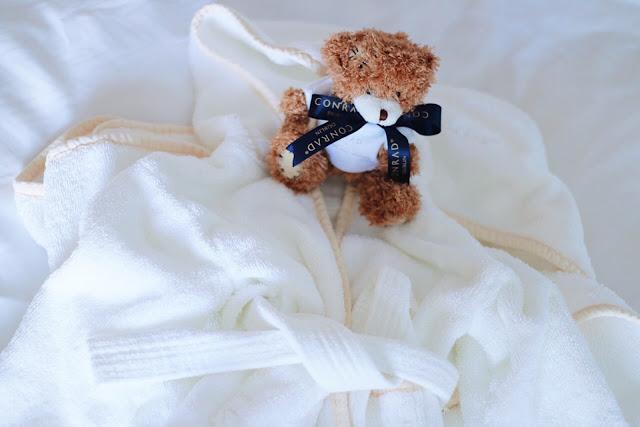 Conrad Dublin hotel review: children's robe, bath towel, and teddy bear