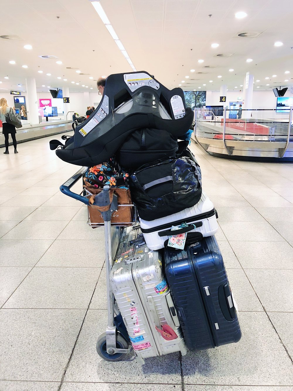 Look at how nicely the Cosco Scenera fits in with the rest of our luggage, ha! (We could never do this kind of stacking with the Nuna Rava, which requires its own massive carrying bag). This was in the Copenhagen airport (one of our final stops on this summer's Europe trip).