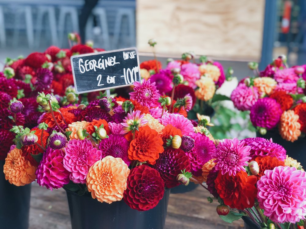 torvehallerne food hall flowers - foods of copenhagen food tour review - travelhappy luxury hawaii travel agency