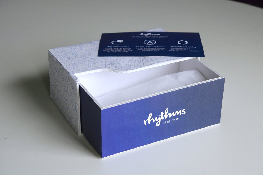 packaging holds Rhythms sensor and setup instructions, contained in a small pillow