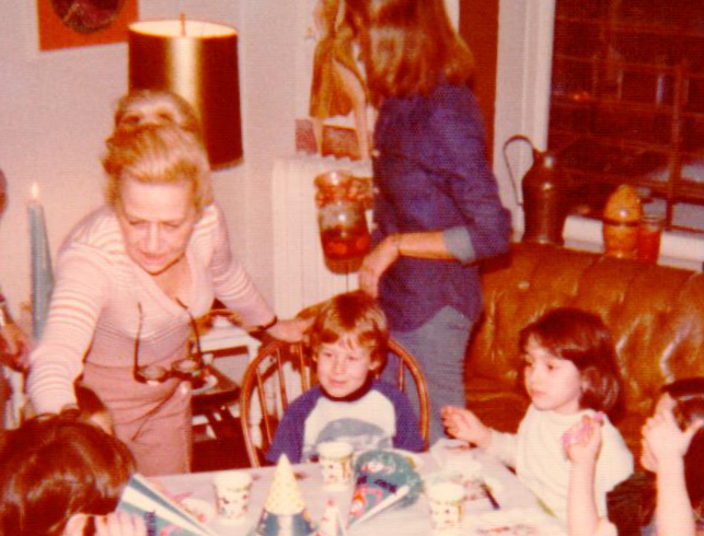 Aunt Molly and I on what looks like my fifth birthday. P.S. — lower right with the hand over her face is the actress, Jennifer Connelly.