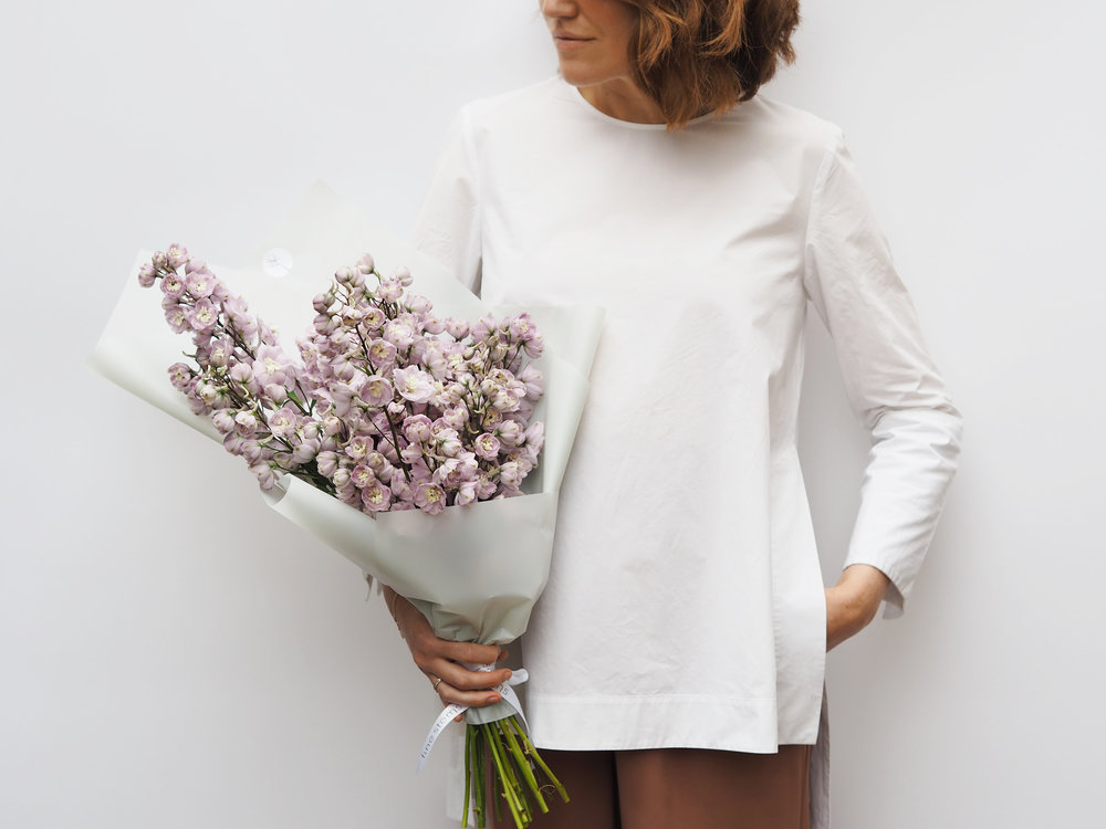 No. 1 - A dusty lilac mono bouquet of delphiniums. These beautiful flowers feature multiple blooms on long stems which gives the arrangements a minimalist statement look.