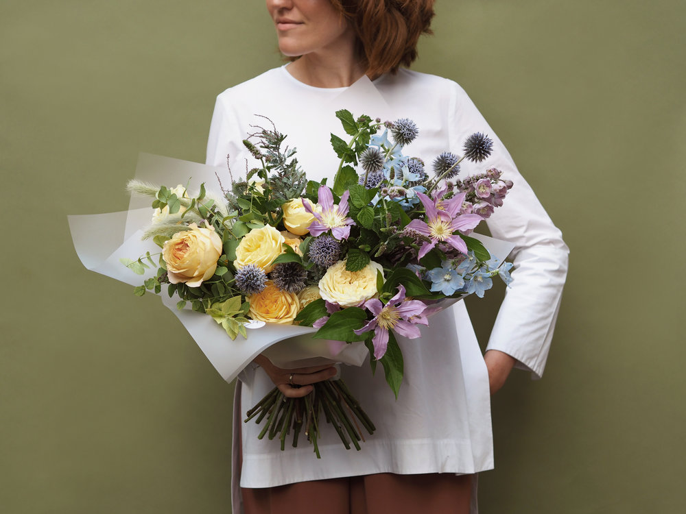 No. 3 - A beautiful bouquet made with a selection of fresh seasonal flowers featuring a mix of Roses, Leather Flower, blue & lilac Delphinium and Eucalyptus.