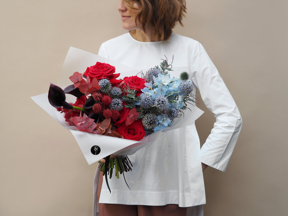 No. 2 - This bouquet is made from a mix of premium large Roses in a variety of colours, Eucalyptus stems, Ricinus, Calla Lilly and blue Delphinium.
