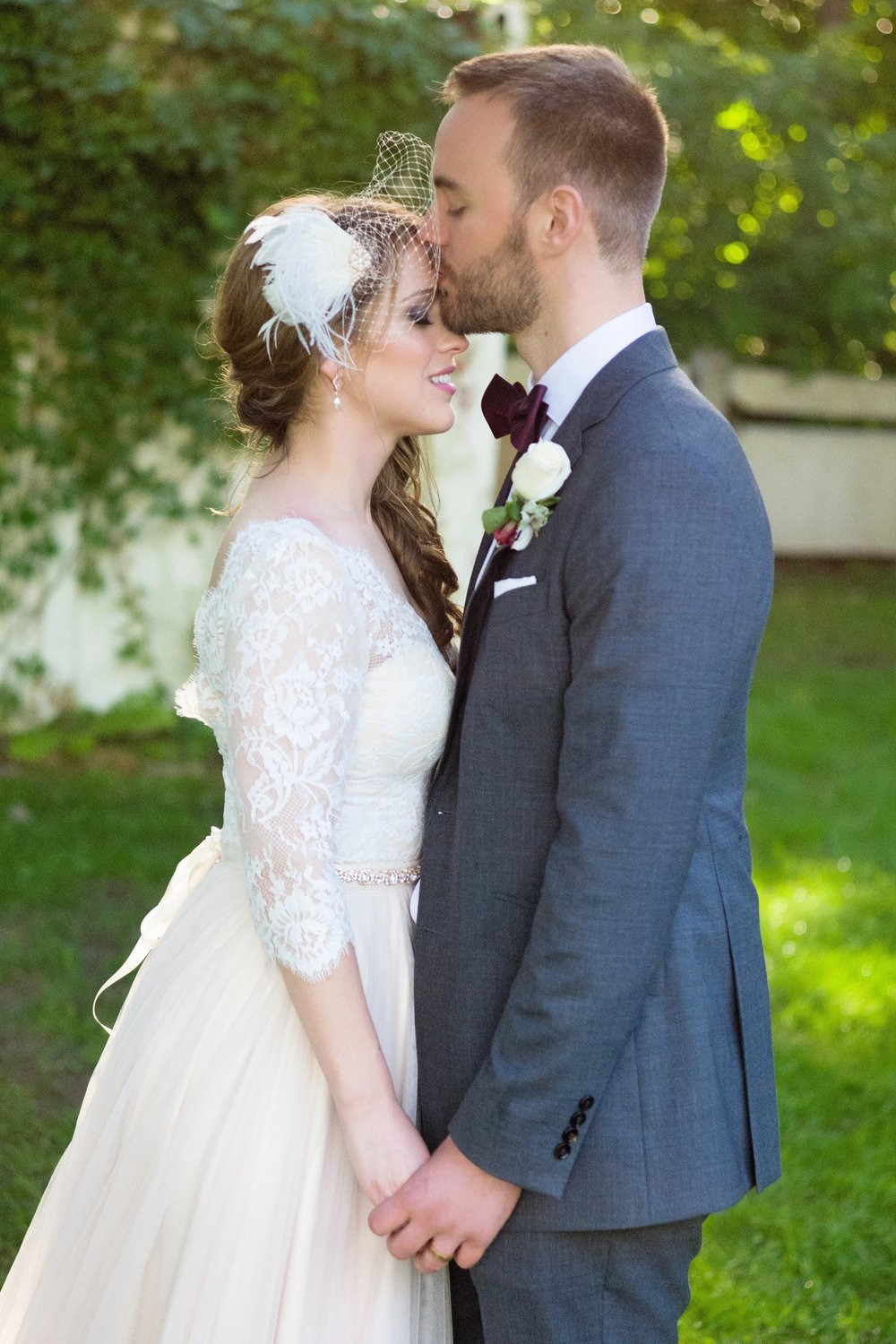 groom-kissing-bride-forehead-mike-lupine-weddings.jpg