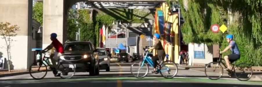 Some customer crossing a junction on our bike rental Vancouver