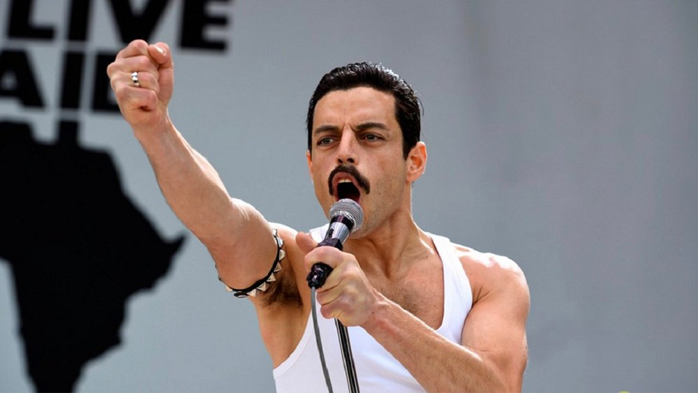 Rami Malek as Freddie Mercury performing at Live Aid, 1985.