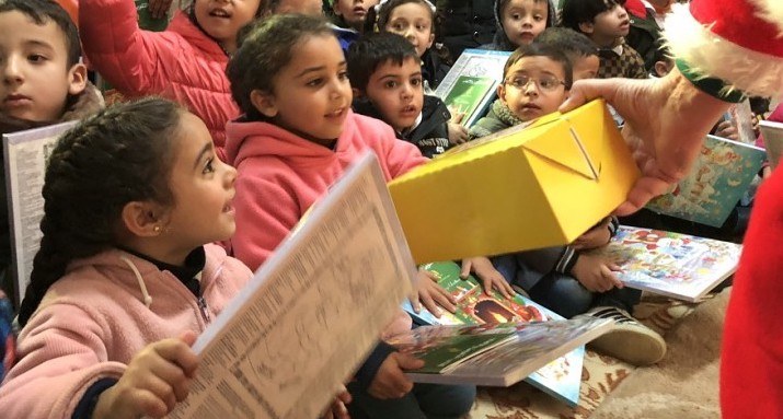 Children receiving gifts at the Artas event.jpg
