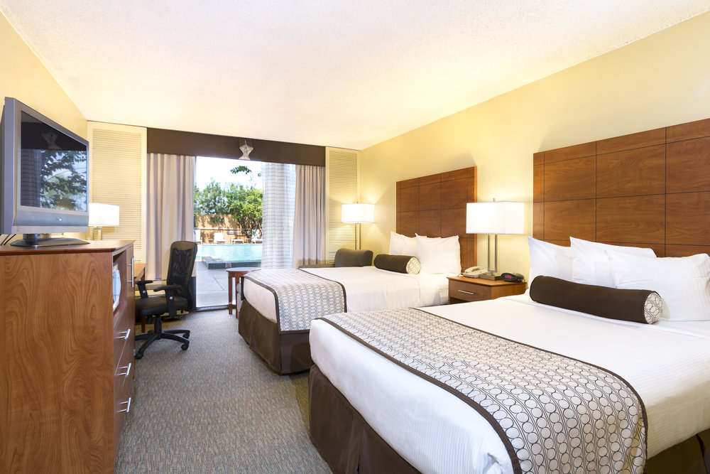 RoOMS - Comfortable rooms with modern amenities, an outdoor pool and more!