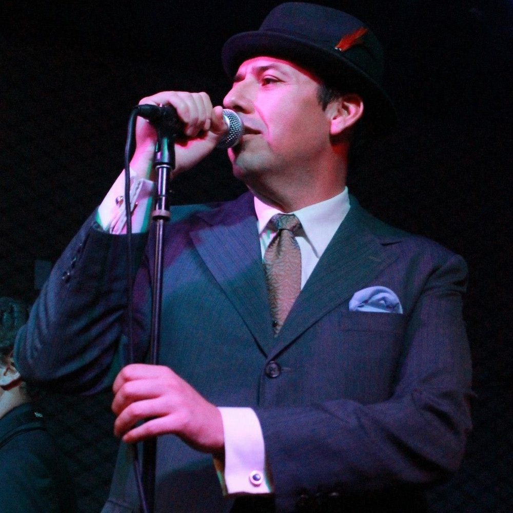 """Raphael """"Rip"""" Pena - Lead Singer for The Amalgamated since May 2009. Former lead singer of The Scotch Bonnets (San Diego). Handles booking, promotions and other administrative functions."""