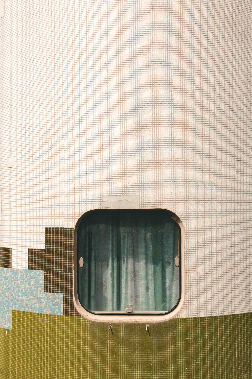 Architecture photograph detail series of the Tours Aillaud, Nanterre. Square opening, with mosaic tile frontage. By Daniel Walker Photography