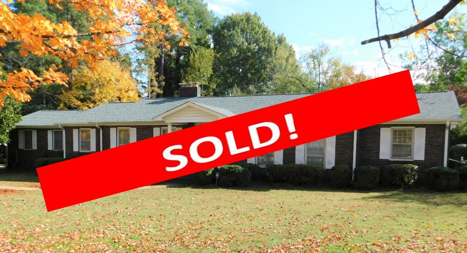 sold -Anderson, SC Absolute Auction - This lovely 4BR 3BA brick ranch-style home is situated on Bellview Road, in Anderson SC. Close to shopping, schools, restaurants, medical facilities, and entertainment, the property boasts a large yard planted with mature trees and shrubs. Curb appeal and location is at its best with this property! An attached two-car carport and an in-ground swimming pool add to the many amenities of this spacious traditional home.