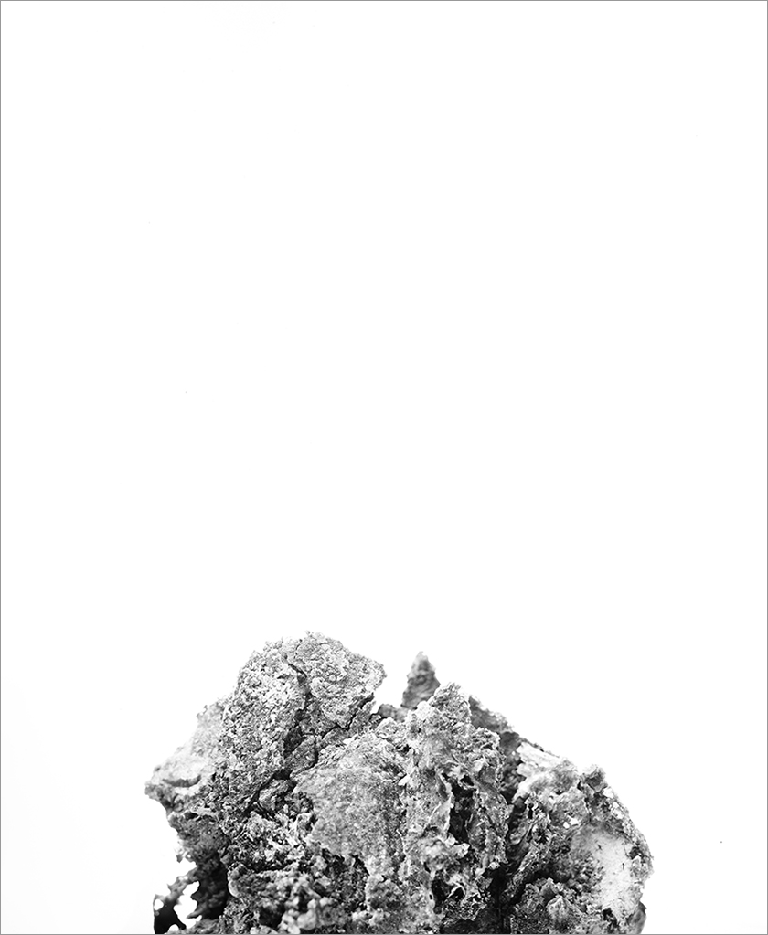 Reclaimed silver creates the mound at the base of   Peak II   (2017) .  The cast off material from the making of countless analog photographs, it is re-imaged, made of and from itself. Its title plays on multiple meanings; is it mountainous, peaking into the frame or prompting the act of looking?  Silver gelatin print  24 x 20 inches